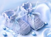 stock photo of booty  - Handmade  pink baby  booties with pearls - JPG
