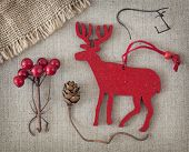 Red christmas deer on fabric background