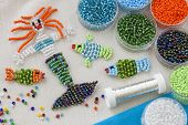 Beaded fishes and mermaid and colorful beads