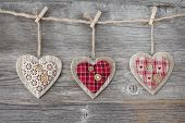 stock photo of clotheslines  - Hearts over a wooden background - JPG