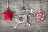 pic of deer  - Wooden christmas deer and red stars on wooden background - JPG