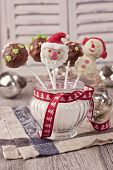 stock photo of cake-ball  - Christmas cake pops in a vase with sugar - JPG