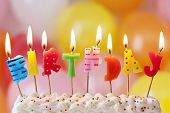 image of icing  - Birthday candles on colorful background - JPG