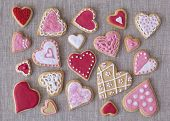 Red and pink heart cookies on a grey fabric background