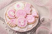 Baby cookies on a pink plate