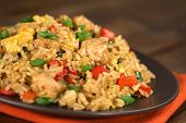 stock photo of fried onion  - Homemade Chinese fried rice with vegetables chicken and fried eggs served on a plate  - JPG