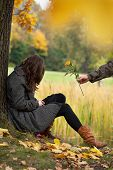 stock photo of apologize  - Young man apologizing girl after quarrel in park - JPG
