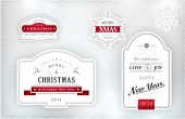 "Set of ""Merry Christmas and Happy New Year"" labels and snowflakes in elegant shades of gray, silver,"