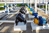 pipes, pump and filter at oil storage
