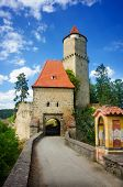 Medieval castle Zvikov in the Czech Republic with round tower, draw-bridge and blue sky