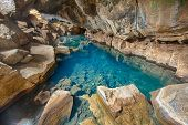 Volcanic cave Grjotagja with a incredibly blue and hot thermal water near lake Myvatn in the northeastern Iceland