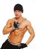 picture of beanie hat  - Handsome muscular man in beanie hat with chain - JPG