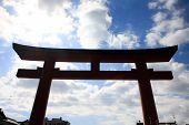 Silhouette Huge Torii View With Clouds Background