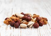 stock photo of mixed nut  - Mixed nuts on a old wooden background