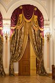 Luxury Decorated Door With Antique Drapery And Candelabras Illumination