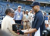 BRONX, NY-JUNE 1; Supercentenarian Bernardo LaPallo, who is 111 years old, shakes hands with New York Yankees shortstop Derek Jeter (R) before a game on June 1, 2013 at Yankee Stadium in the Bronx.