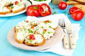 image of hardtack  - Sandwiches with cottage cheese and greens on plate on wooden table close - JPG