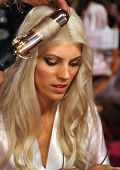 NEW YORK NY - NOVEMBER 13: Model Devon Windsor prepares backstage
