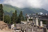 construction of the cable way in the mountains (Krasnaya Polyana, Sochi, Russia)