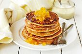 A Stack Of Pumpkin Pancakes Topped With Pumpkin-in-syrup Preserves