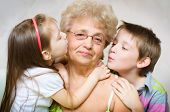 Grandchildren Kissing Grandmother