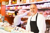 foto of salami  - People at work in a grocery store - JPG
