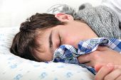 stock photo of rhinitis  - Sick Young Man sleeps with Hanky closeup - JPG