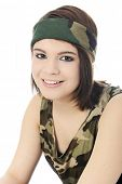 Close-up portrait of a beautiful girl in a camouflage headband and sleeveless shirt.  On a white bac