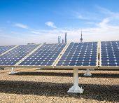Solar Power With Modern City Background