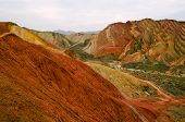 stock photo of landforms  - Zhangye Danxia landform located in Linze County, an area more than one hundred square hilly areas, there are strange shapes, colors spot a false charge, the magnificent landform. Danxia landform is peeling red conglomerate 