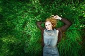 Beautiful Meditative Young Woman Lying In The Grass. Summer, Freedom Concept.