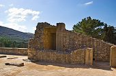 image of minos  - The ruins of Knossos Palace with the green hill on the background Crete Greece - JPG