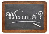 Who am I ? A philosophical question  on a vintage blackboard with white chalk, isolated on white