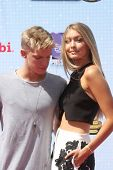 LOS ANGELES - APR 26:  Cody Simpson, Gigi Hadid at the 2014 Radio Disney Music Awards at Nokia Theater on April 26, 2014 in Los Angeles, CA