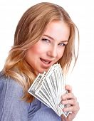 Closeup portrait of pretty woman with leer holding in hands a wad of dollars isolated on white backg