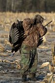 picture of gobbler  - A young turkey hunter in the spring with a large turkey - JPG