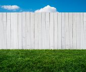 foto of wooden fence  - white garden fence on a green grass - JPG