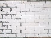 picture of untidiness  - Untidy wall built symbolize of unprofessional construction - JPG