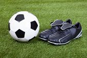 Football And Cleats On The Field