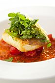 stock photo of halibut  - Halibut Fillet with Tomato Sauce and Rucola - JPG