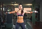 picture of six pack  - Portrait of a gorgeous young brunette woman working out - JPG