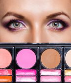 Closeup Of Beautiful Eyes With Makeup Kit And Glamorous Makeup