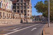 stock photo of zurich  - Street in Zurich Switzerland with building decorated with flags of Zurich and Switzerland - JPG