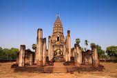 Sukhothai ruin old pagoda against blue sky at Wat Phra Sri Rattana Mahathat in Si Satchanalai histor