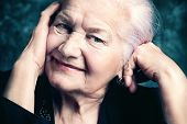 foto of retirement age  - Portrait of a beautiful smiling senior woman - JPG