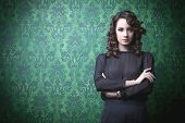 Beautiful Woman In Green Vintage Room