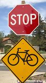 Bike lane sign and Stop sign