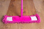 Close Up Of Pink Cleaning Mop On Wooden Floor - Before After