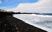 Waves Roll Onto Stony Beach