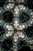 woman with helmet in a kaleidoscope of mirrors